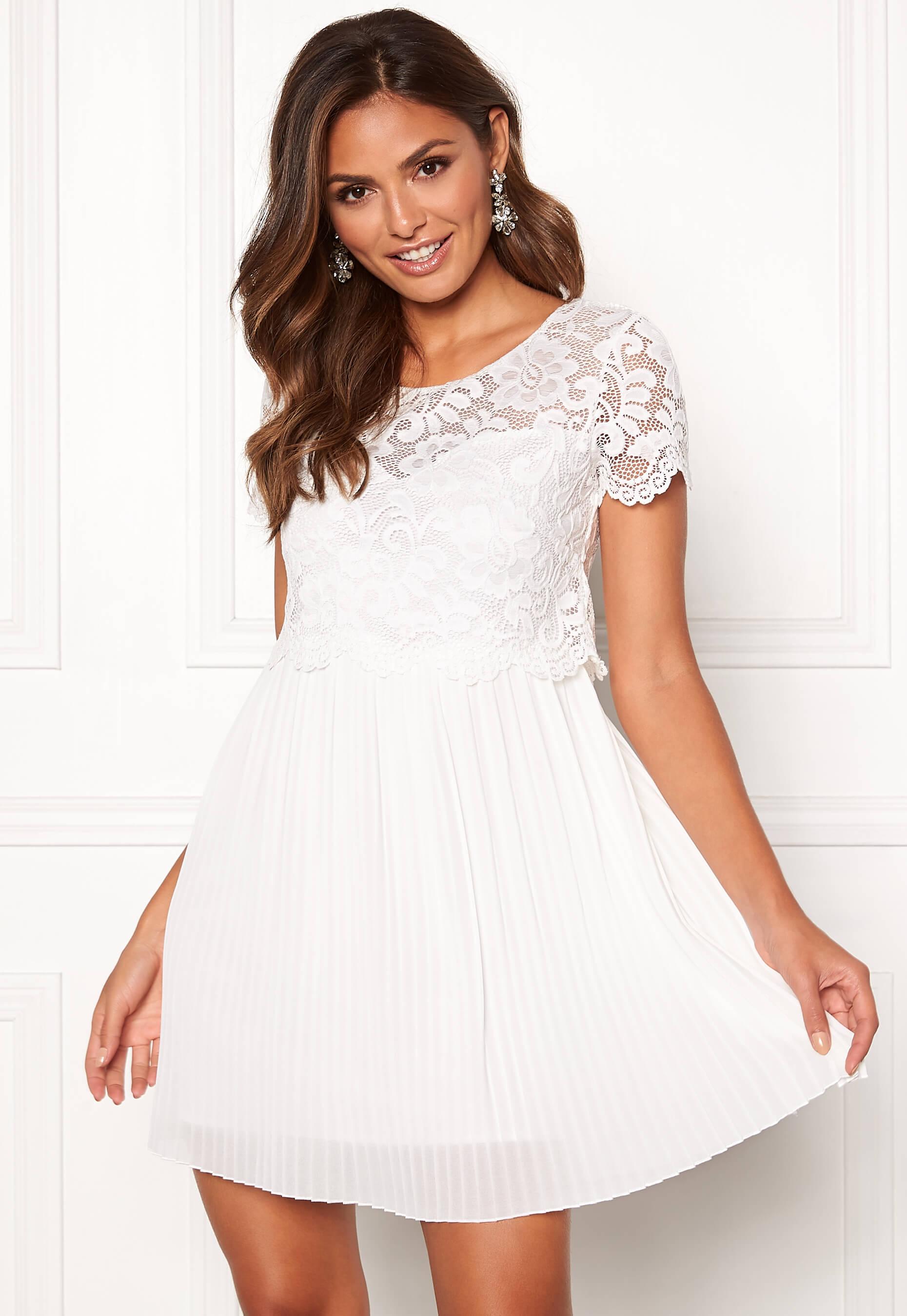 Vacker vit klänning i stretchig spets och chiffong